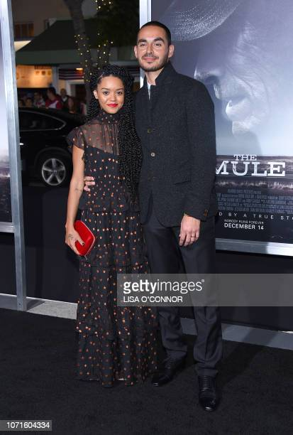 Actor Manny Montana and Adelfa Marr arrive for the premiere of The Mule at the Regency Village theatre in Westwood California on December 10 2018