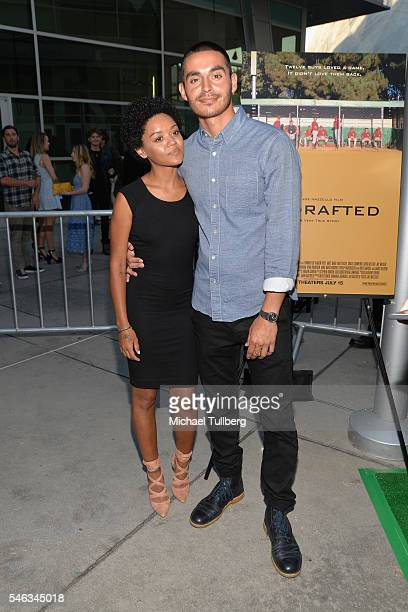 Actor Manny Montana and guest attend the premiere of Vertical Entertainment's Undrafted at ArcLight Hollywood on July 11 2016 in Hollywood California