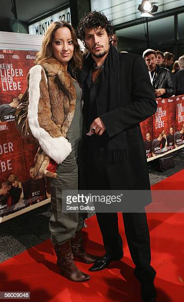 Actor Manuel Cortez and friend Miyabi Kawai arrive for the premiere of Keine Lieder Ueber Liebe on October 25 2005 in Berlin Germany