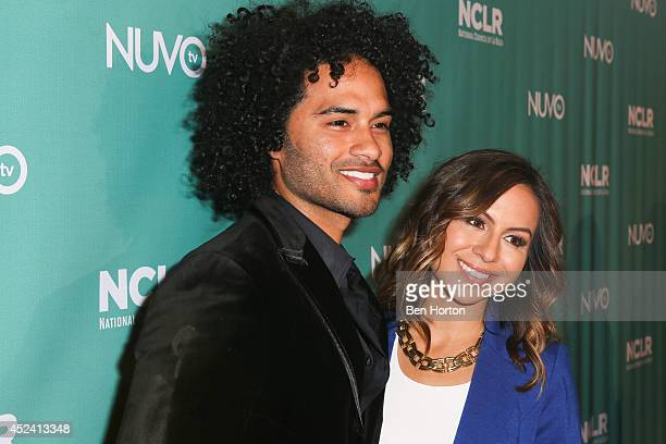 Actor Manwell Reyes and comedian Anjelah Johnson attend the NUVOtv Comedy Night at Los Angeles Convention Center on July 19 2014 in Los Angeles...