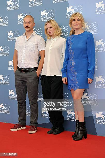 Actor MarcAndre Grondin actress Christa Theret and actress Emmanuelle Seigner attend 'L'Homme Qui Rit' Photocall during The 69th Venice Film...