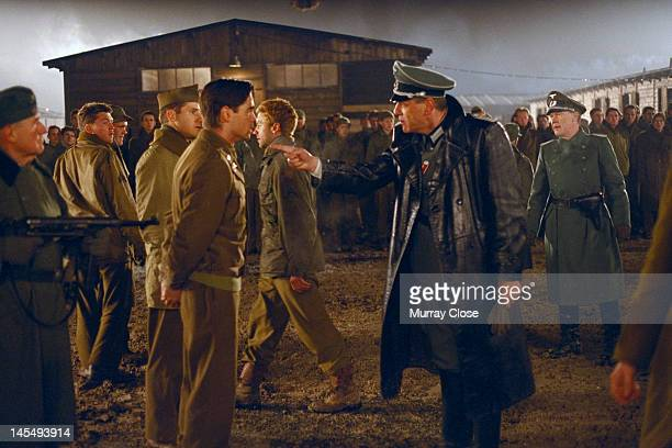 Actor Marcel Iures as the Camp Commandant confronts Colin Farrell in a scene from the film 'Hart's War' 2002 Behind them are actors Sam Jaeger...