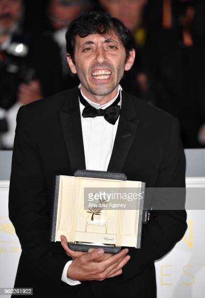 Actor Marcello Fonte poses with the Best Actor award for his role in 'Dogman' during the photocall at the 71st Cannes Film Festival in Cannes France...