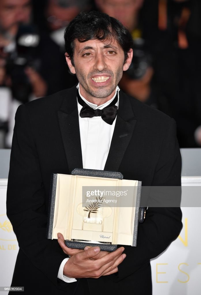 Actor Marcello Fonte poses with the Best Actor award for his role in 'Dogman' during the photocall at the 71st Cannes Film Festival in Cannes, France on May 19, 2018.
