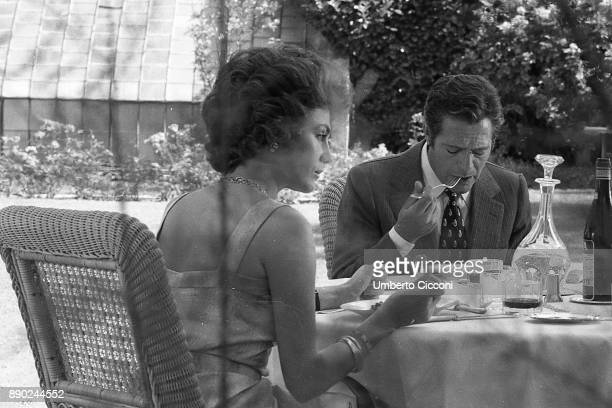 Actor Marcello Mastroianni and actress Jacqueline Bisset acting during the filming of movie 'The Sunday Woman' Rome 1975