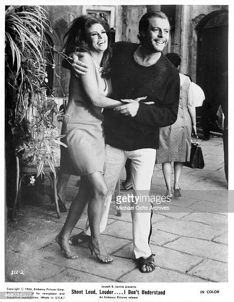 Actor Marcello Mastroianni and actress Raquel Welch on set of the movie Shoot Loud Louder I Don't Understand circa 1966
