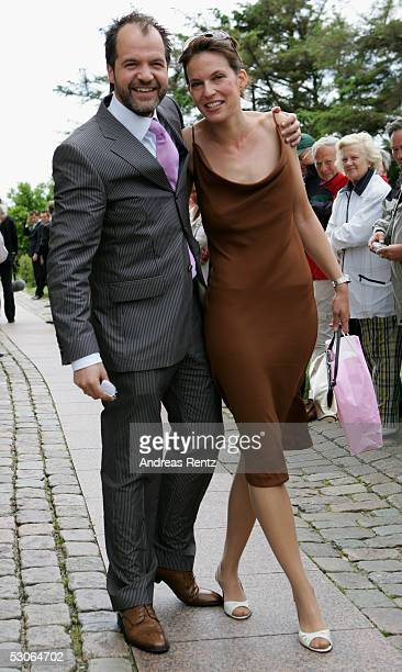 Actor Marek Erhardt and his wife Maren pose for a photograph at the Sankt Severin church on June 11 2005 at Sylt in Germany Michael Stich and...