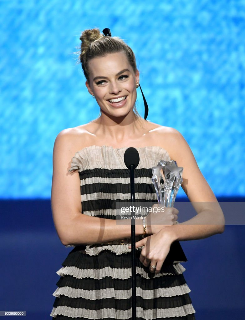 Actor Margot Robbie accepts Best Actress in a Comedy for 'I, Tonya' onstage during The 23rd Annual Critics' Choice Awards at Barker Hangar on January 11, 2018 in Santa Monica, California.
