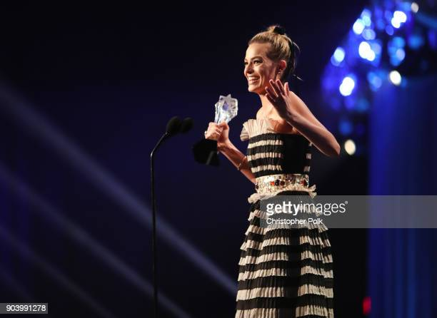Actor Margot Robbie accepts Best Actress in a Comedy for 'I Tonya' onstage during The 23rd Annual Critics' Choice Awards at Barker Hangar on January...