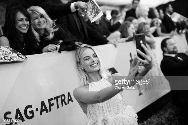 Actor Margot Robbie takes a selfie with guests at the 24th Annual Screen Actors Guild Awards at The Shrine Auditorium on January 21 2018 in Los...