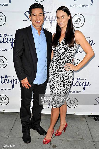 Actor Mario Lopez and athlete Amanda Beard arrive at Softcup's cocktail party with hosts Mario Lopez and Amanda Beard at the Andaz Hotel on August 5...