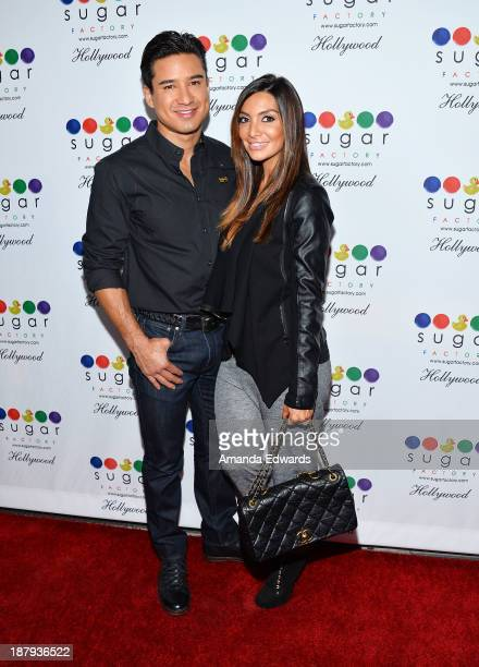 Actor Mario Lopez and his wife Courtney Mazza arrive at the grand opening of Sugar Factory Hollywood at Sugar Factory on November 13 2013 in...