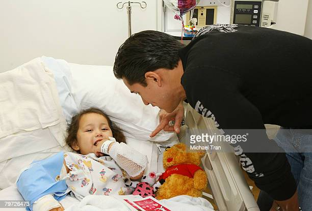 Actor Mario Lopez and pediatric patient Amanda Mendez celebrate Valentines Day in the pediatric ward at Santa MonicaUCLA and Orthopedic Hospital on...