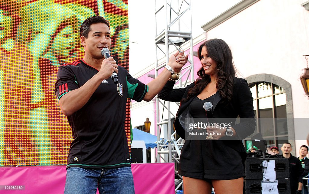 Actor Mario Lopez and singer Jazmin Lopez speak onstage during the T-Mobile World Cup Viewing Party at Plaza Mexico on June 11 at Plaza Mexico in Lynwood, CA.