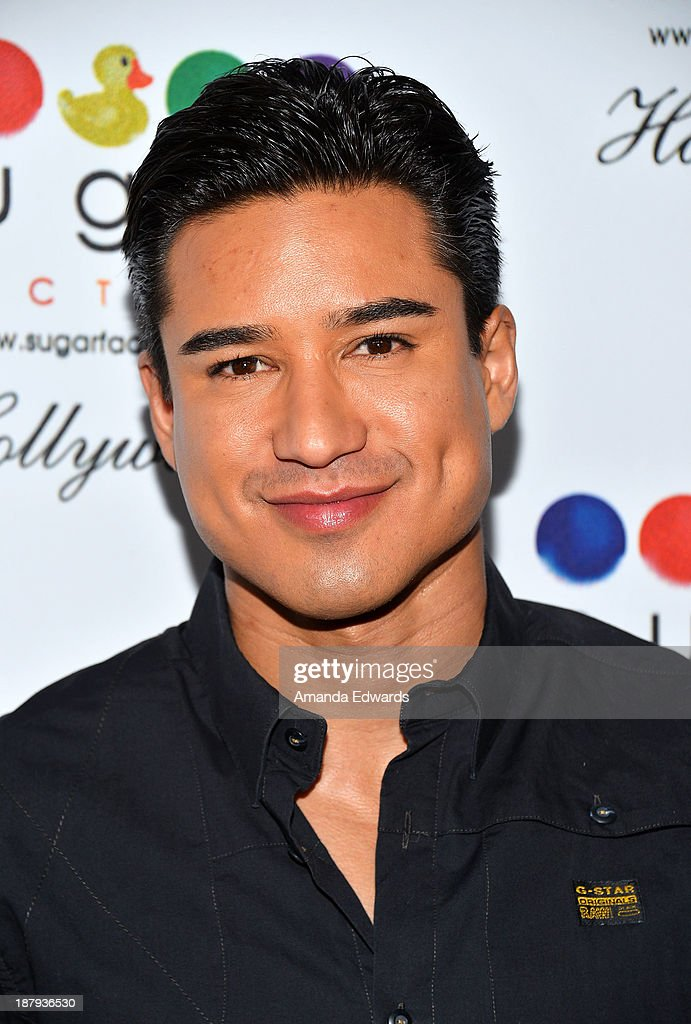 Actor Mario Lopez arrives at the grand opening of Sugar Factory Hollywood at Sugar Factory on November 13, 2013 in Hollywood, California.