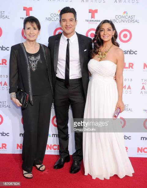 Actor Mario Lopez mom Elvia Lopez and wife Courtney Mazza arrive at the 2013 NCLA ALMA Awards at Pasadena Civic Auditorium on September 27 2013 in...