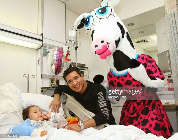 Actor Mario Lopez poses with pediatric patient Amanda Mendez and Miss MaggieMoo of MaggieMoo's Treatery celebrate Valentines Day in the pediatric...
