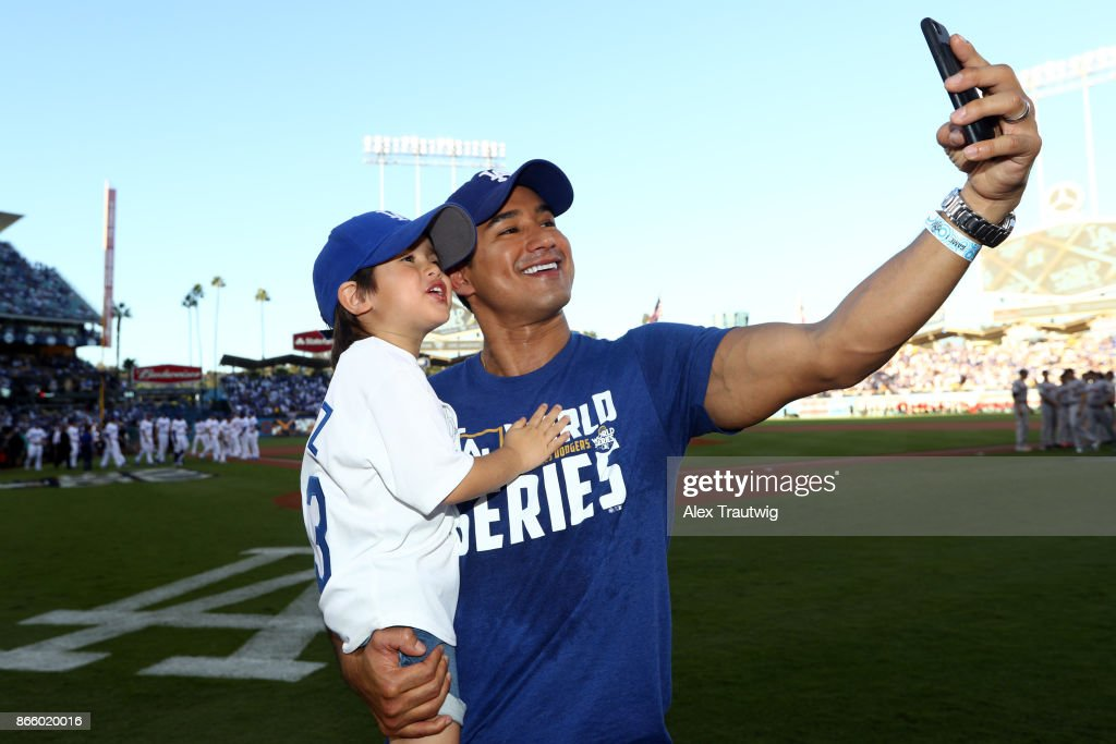 Actor Mario Lopez takes a selfie on the field prior to Game 1 of the 2017 World Series between the Houston Astros and the Los Angeles Dodgers at Dodger Stadium on Tuesday, October 24, 2017 in Los Angeles, California.