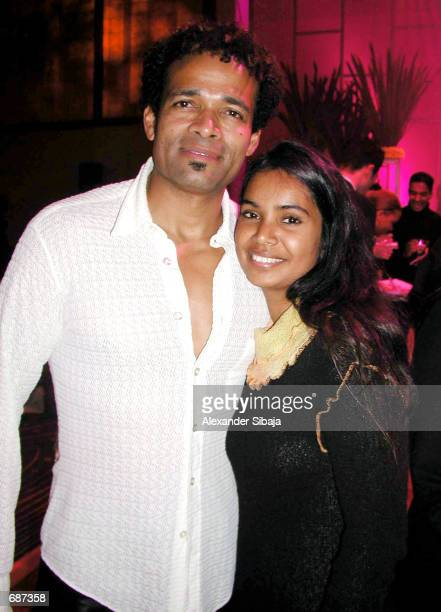 Actor Mario Van Peebles poses with his friend Chitra Sukhu during the afterparty for Ali at the Grand Ballroom of the Kodak Theater December 12 2001...