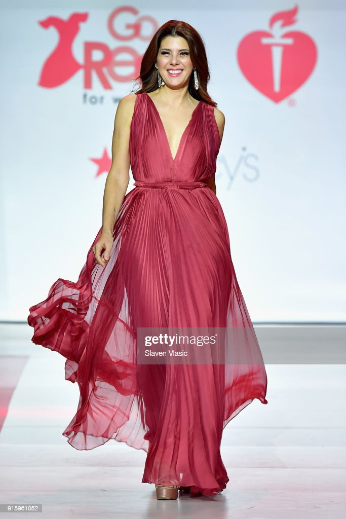 Actor Marisa Tomei walks the runway during the American Heart Association's Go Red For Women Red Dress Collection 2018 presented by Macy's at Hammerstein Ballroom on February 8, 2018 in New York City.