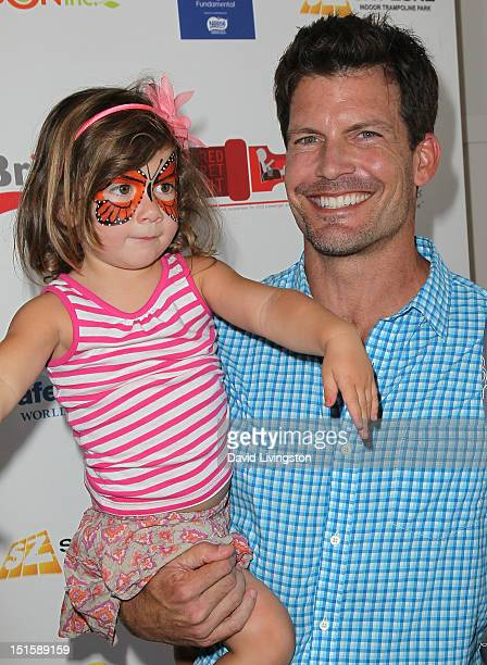 Actor Mark Deklin and daughter attend the 2nd Annual Red CARpet event at SLS Hotel on September 8 2012 in Beverly Hills California
