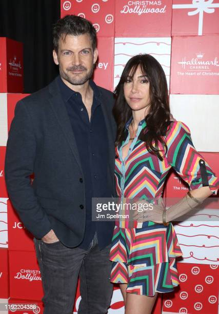 "Actor Mark Deklin and guest attend the New York screening of Hallmark Channel's ""Christmas At Dollywood"" at Village East Cinema on December 05, 2019..."