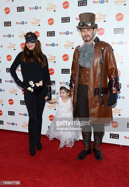 Actor Mark Deklin and his family arrive at the Keep A Child Alive 2012 Dream Halloween Party at Barker Hangar on October 27 2012 in Santa Monica...