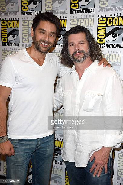 """Actor Mark Ghanime and writer/producer Ronald D. Moore attend the """"Helix"""" press line during Comic-Con International 2014 at Hilton Bayfront on July..."""