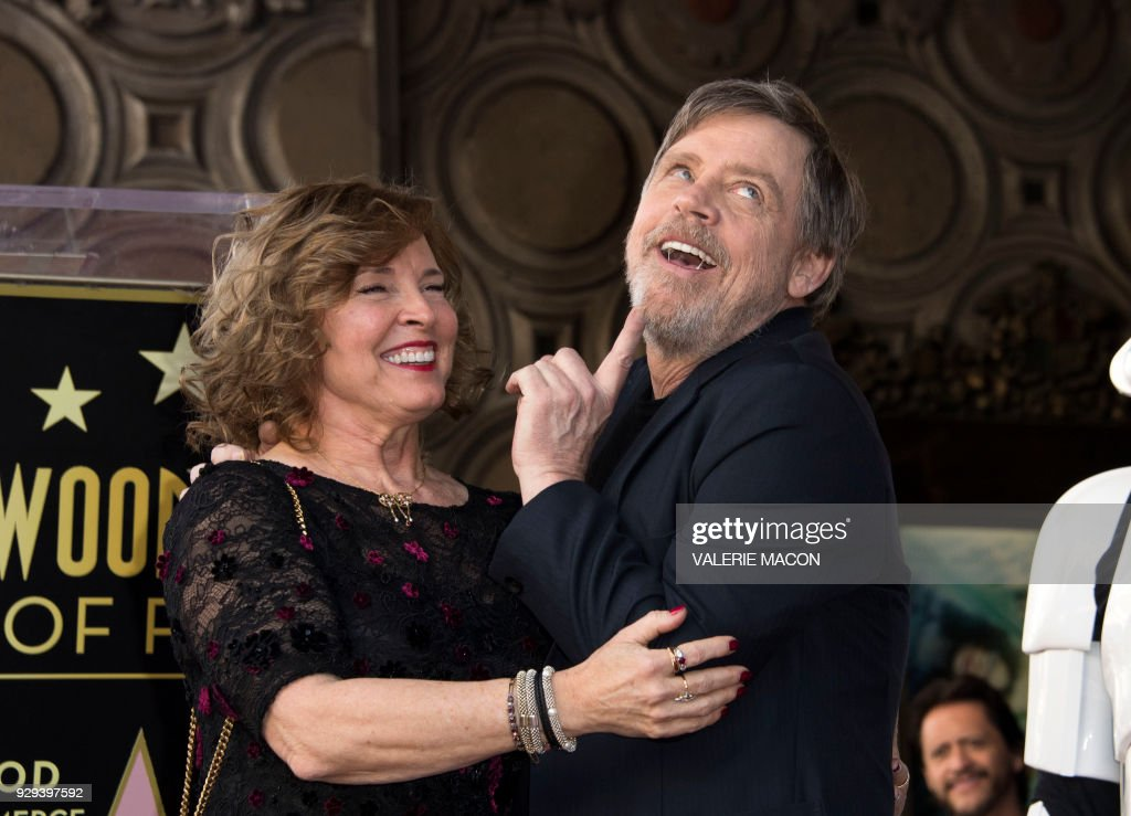 Actor Mark Hamill and his wife, Marilou York, attend the ceremony honoring Hamill with a star on the Hollywood Walk of Fame on March 8, 2018, in Hollywood, California. /