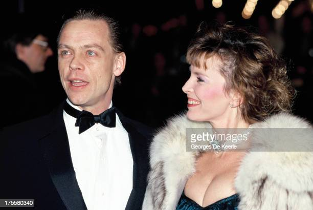 Actor Mark Hamill best known for starring as Luke Skywalker in the Star Wars saga and his wife Marilou York attend a premiere on February 11 1989 in...