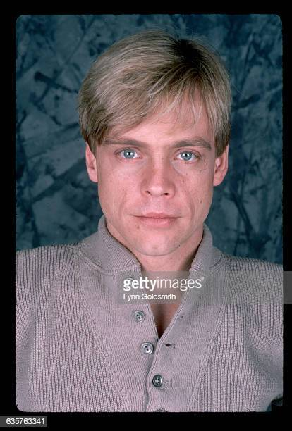 Actor Mark Hamill is shown in this closeup studio portrait His hair is blonde and he wears a tan roundcollared shirt with buttons Undated