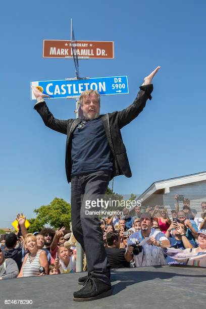Actor Mark Hamill of Star Wars poses for a photo in front of the street sign dedicated in his honor on July 30 2017 in San Diego California