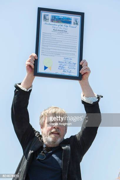 Actor Mark Hamill of Star Wars receives a plaque from the City of San Diego proclaiming July 30 2017 as Mark Hamill Day on July 30 2017 in San Diego...