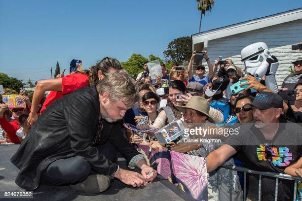 Actor Mark Hamill of Star Wars signs autographs for fans at the Mark Hamill Drive Dedication on July 30 2017 in San Diego California