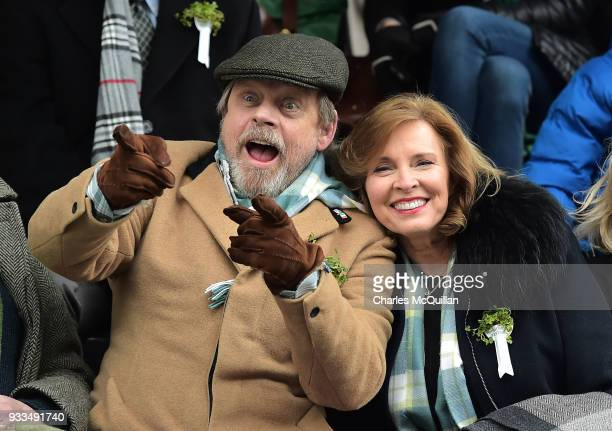 Actor Mark Hamill pictured with his wife Mary Lou Hamill watch as guests from the Presidents grandstand as the annual Saint Patrick's day parade...