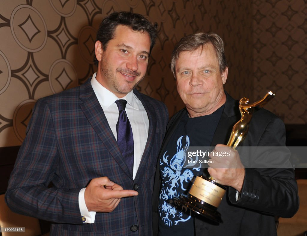 Actor Mark Hamill (R) poses backstage with Jonathan Block-Verk, President and CEO of PromaxBDA Global International after receiving the Don LaFontaine Award at PromaxBDA Promotion, Marketing And Design Awards Show at JW Marriott Los Angeles at L.A. LIVE on June 20, 2013 in Los Angeles, California.