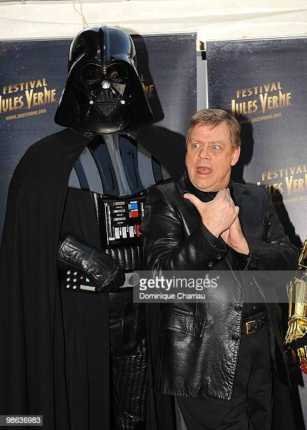Actor Mark Hamill poses with Darth Vader as he attends a Tribute to Star Wars V during the 18th Adventure Film Festival at Le Grand Rex on April 23...