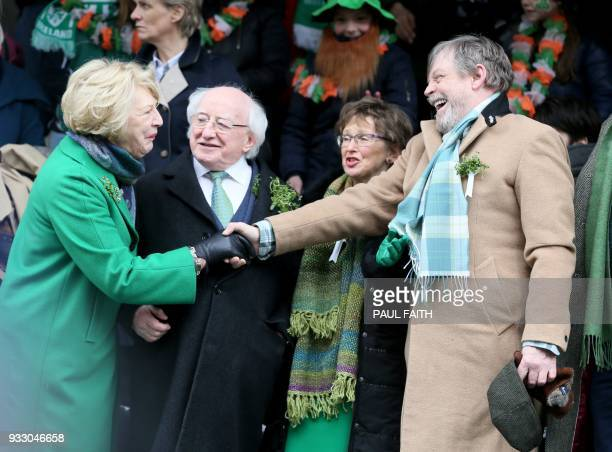 US actor Mark Hamill shakes hands with Irish President Michael D Higgins and his wife Sabrina as he attends as international guest of honour during...