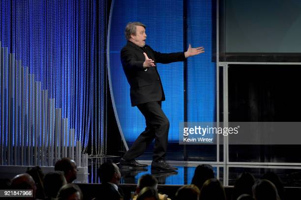 Actor Mark Hamill walks onstage during the Costume Designers Guild Awards at The Beverly Hilton Hotel on February 20 2018 in Beverly Hills California