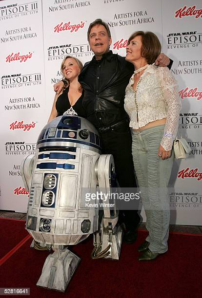 Actor Mark Hamill with daughter Chelsea and wife Marilou pose with R2D2 as they arrive at the Star Wars Episode III Revenge Of The Sith Los Angeles...