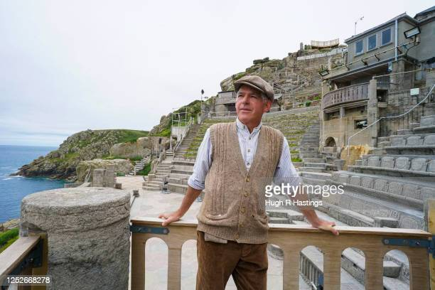 Actor Mark Harandon poses for the photographer at the open air Minack Theatre set in to the cliffs at Porthcurno on June 26 2020 in Cornwall United...