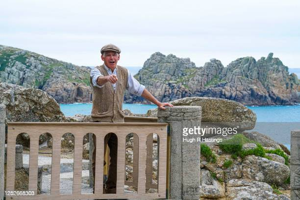 Actor Mark Harandon rehearsing alone at the open air Minack Theatre set in to the cliffs at Porthcurno on June 26 2020 in Cornwall United Kingdom...