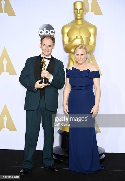Actor Mark Rylance winner of the Best Actor in a Supporting Role award for 'Bridge of Spies' poses with actress Patricia Arquette in the press room...