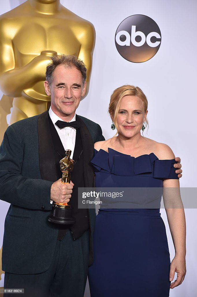 Actor Mark Rylance (L), winner of the Best Actor in a Supporting Role award for 'Bridge of Spies,' poses with actress Patricia Arquette in the press room during the 88th Annual Academy Awards at Loews Hollywood Hotel on February 28, 2016 in Hollywood, California.