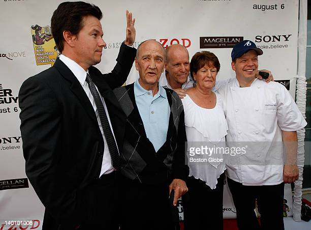 Actor Mark Wahlberg a Boston native poses with members of his family outside the restaurant Alma Nove in Hingham where he is hosting a special...