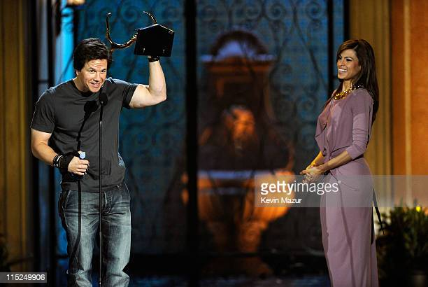 Actor Mark Wahlberg accepts an award from actress Eva Mendes onstage during Spike TV's 5th annual 2011 Guys Choice Awards at Sony Pictures Studios on...