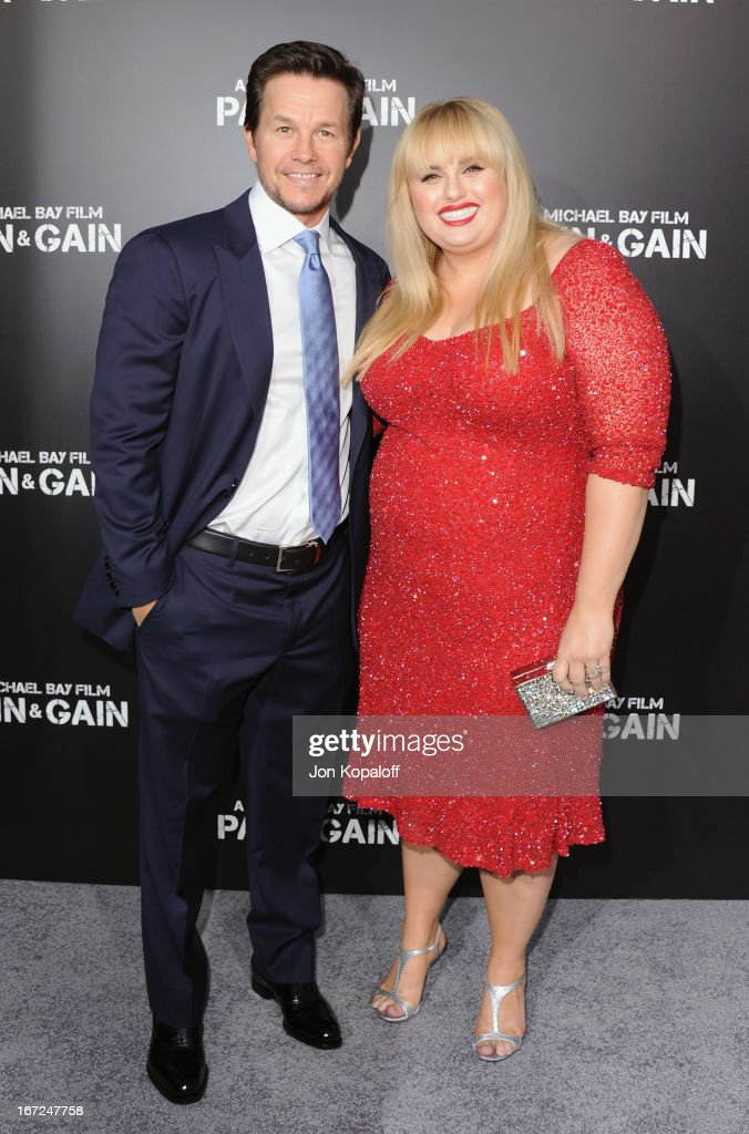 Actor Mark Wahlberg and actress Rebel Wilson arrive at the Los Angeles Premiere 'Pain & Gain' at TCL Chinese Theatre on April 22, 2013 in Hollywood, California.