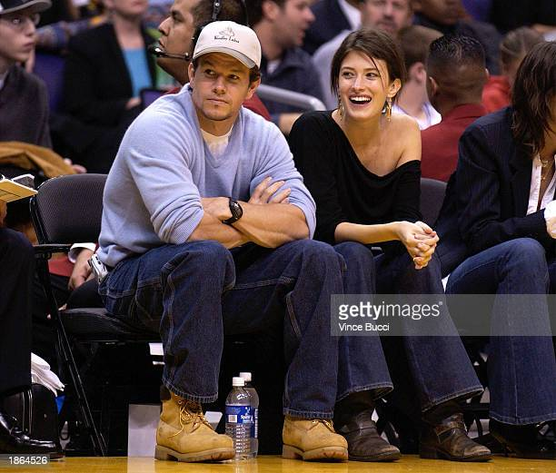 Actor Mark Wahlberg and an unidentified friend attend the game between the Los Angeles Lakers and the Boston Celtics on March 21 2003 at the Staples...