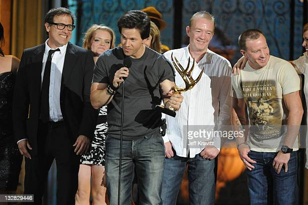 Actor Mark Wahlberg and boxers Dicky Eklund and Micky Eklund accept an award onstage during Spike TV's 5th annual 2011 Guys Choice Awards at Sony...