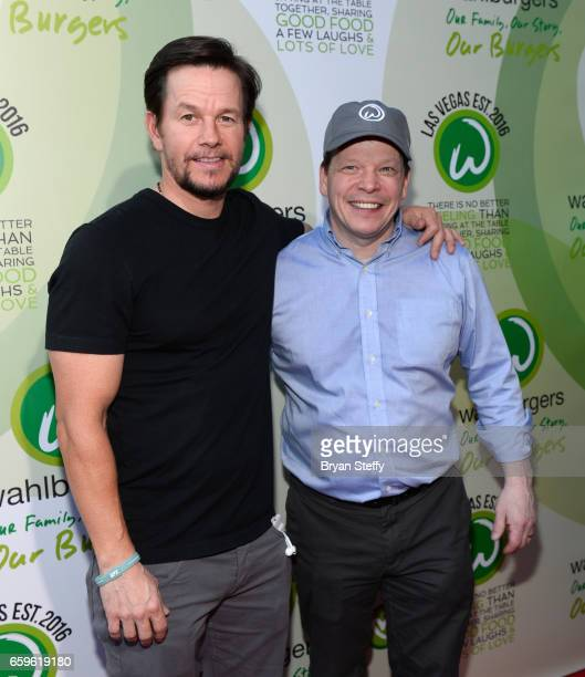 Actor Mark Wahlberg and brother executive chef Paul Wahlberg arrive at a VIP event at Wahlburgers Las Vegas at the Grand Bazaar Shops at Bally's Las...